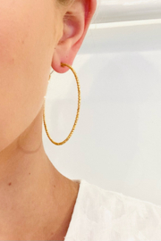 Jen Collection  14K Yellow Gold Italian Made Diamond Cut Hoops (2.5 diameter) - Front cropped