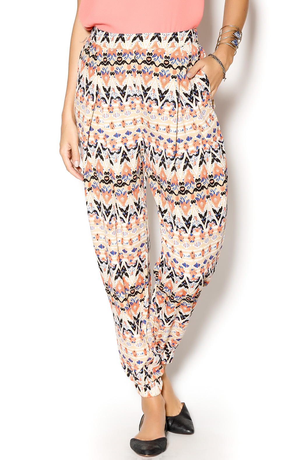 Beautiful imported harem pants from India with colorful cream and multi paisley pattern base and contrasting border at sides and ankles. These full pantaloons are perfect for Tribal Style, Tribaret, or Cabaret belly dance costuming.