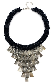 Ananda Chicago  Ananda Statements - Front cropped