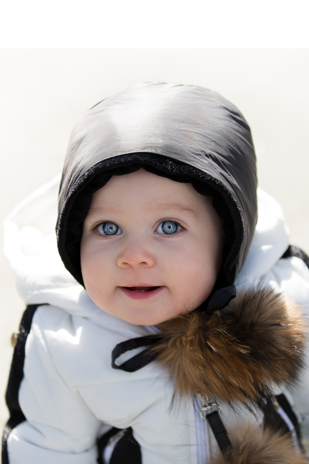 COZY COOP  BABY QUILTED CAP - SHINY BLACK PADDED WITH FUR POM POMS - Main Image