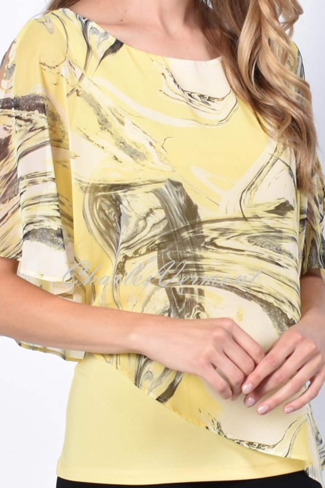 Frank Lyman Black abstract print on yellow fine chiffon overlay. Longer length yellow camisole top. - Front Full Image