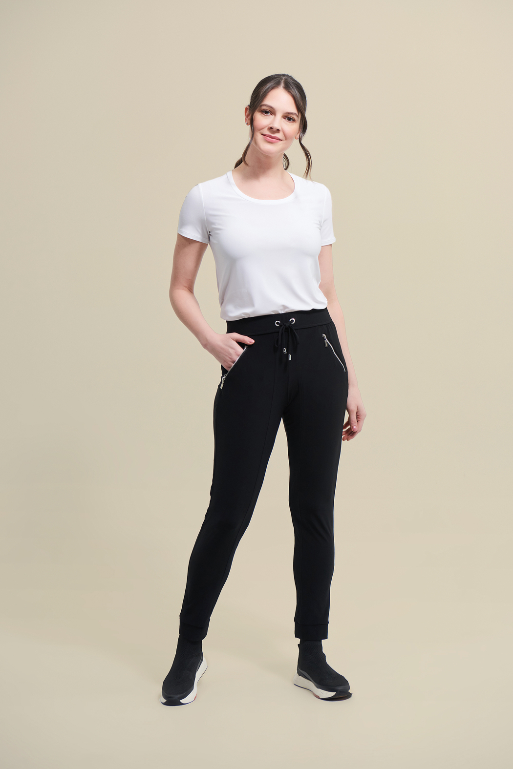 Joseph Ribkoff  Stretchy, black drawstring pants with zip pockets. - Front Full Image