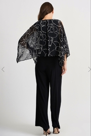 Joseph Ribkoff  Black and white jumpsuit, flowy scarf like top; very slimming. - Product Mini Image