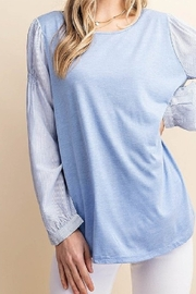 Kori Blue knit and woven top with striped long sleeves - Front cropped