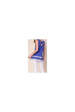 KORI AMERICA Blue knit sleeveless top with striped ruffle accents and caged back - Alternate List Image