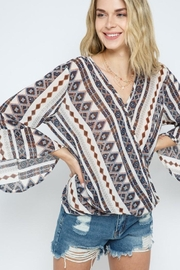 Blue B Tribal Print Ruffle Long Sleeve Cross Layer Top - Product Mini Image