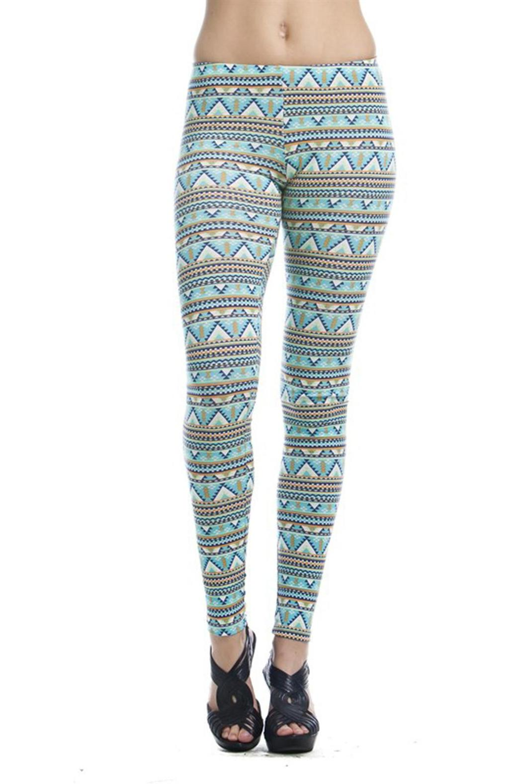 Pair an Aztec waterfall cardigan or oversized sweater, with a pair of leggings or jeggings, and riding boots. You end up with a look that is comfy, cute, and on trend. Source.