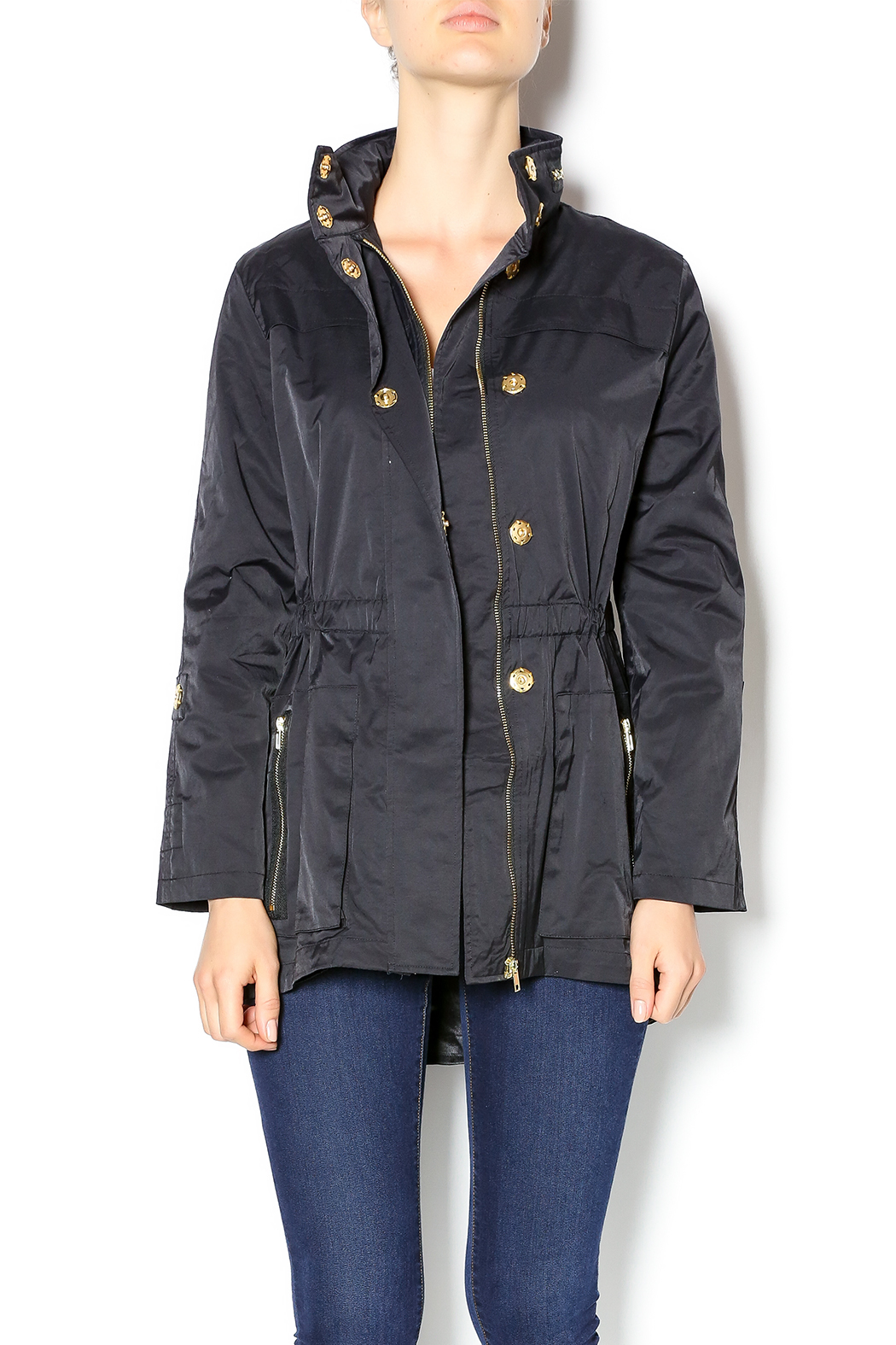 Constructed of extremely lightweight nylon that has been treated to be water resistant, this travel anorak jacket is designed to be stuffed into either of its lower pockets .