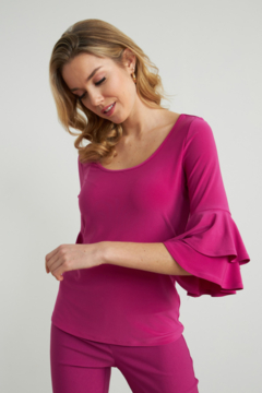 Joseph Ribkoff  Comfortable top with scoop neckline. Ruffle cuff sleeves and hem that arrives at the waist. - Product List Image