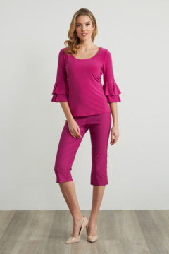 Joseph Ribkoff  Comfortable top with scoop neckline. Ruffle cuff sleeves and hem that arrives at the waist. - Alternate List Image