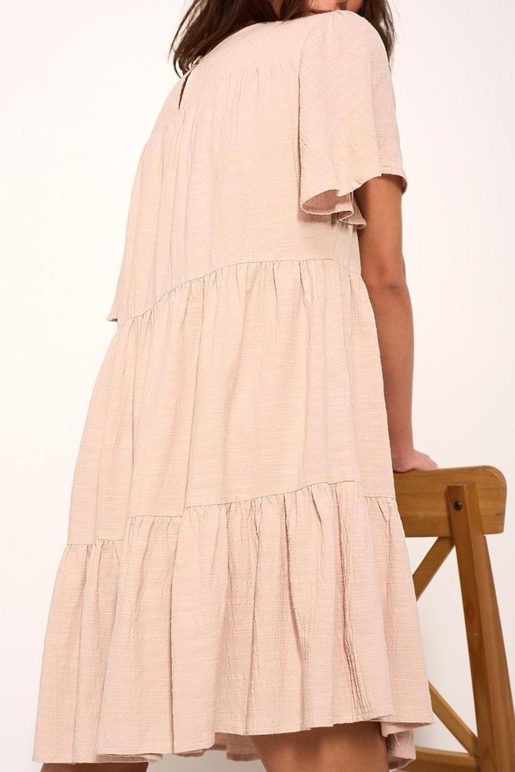 crescent Whimsical Tiered Babydoll Dress In Sand - Front Full Image