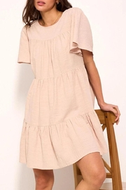 crescent Whimsical Tiered Babydoll Dress In Sand - Product Mini Image