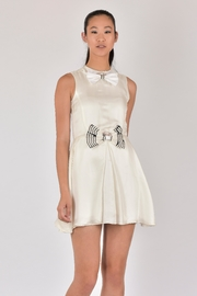Available Now: MINI FLARED DRESS at RMNOnline Fashion Group. Asian Model Wearing X-Small
