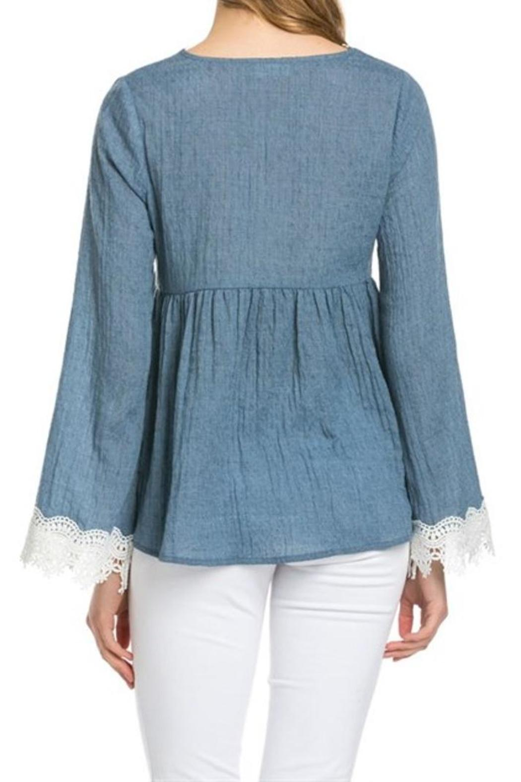 d25462aa485 Denim Bell-Sleeve Top from Laredo by Dollz Boutique — Shoptiques