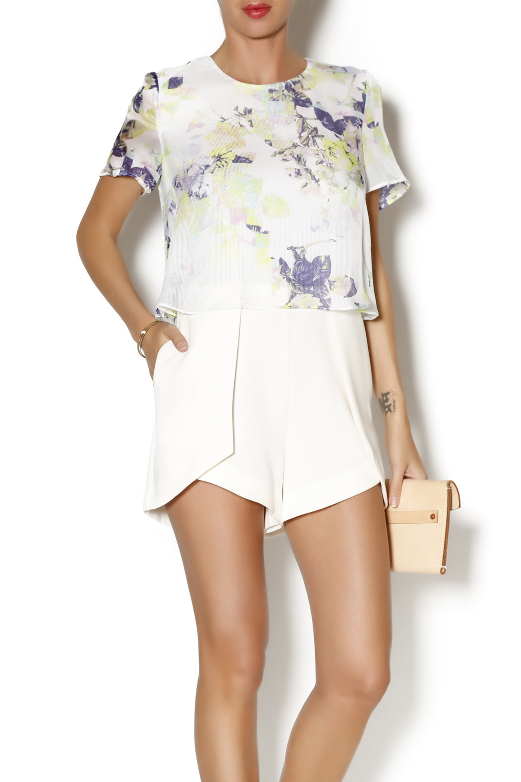 594e411171a0 BCBGeneration Floral Ivory Romper from Omaha by Statement — Shoptiques