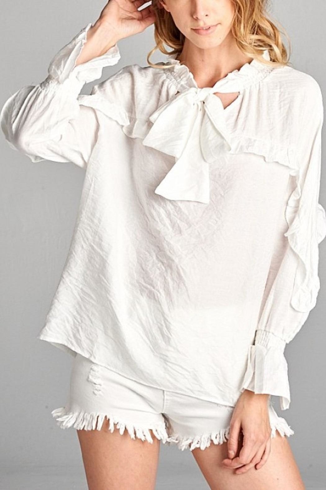ed8a9177c45 Ellison White Ruffle Button Down from Georgia by Posh Clothing ...