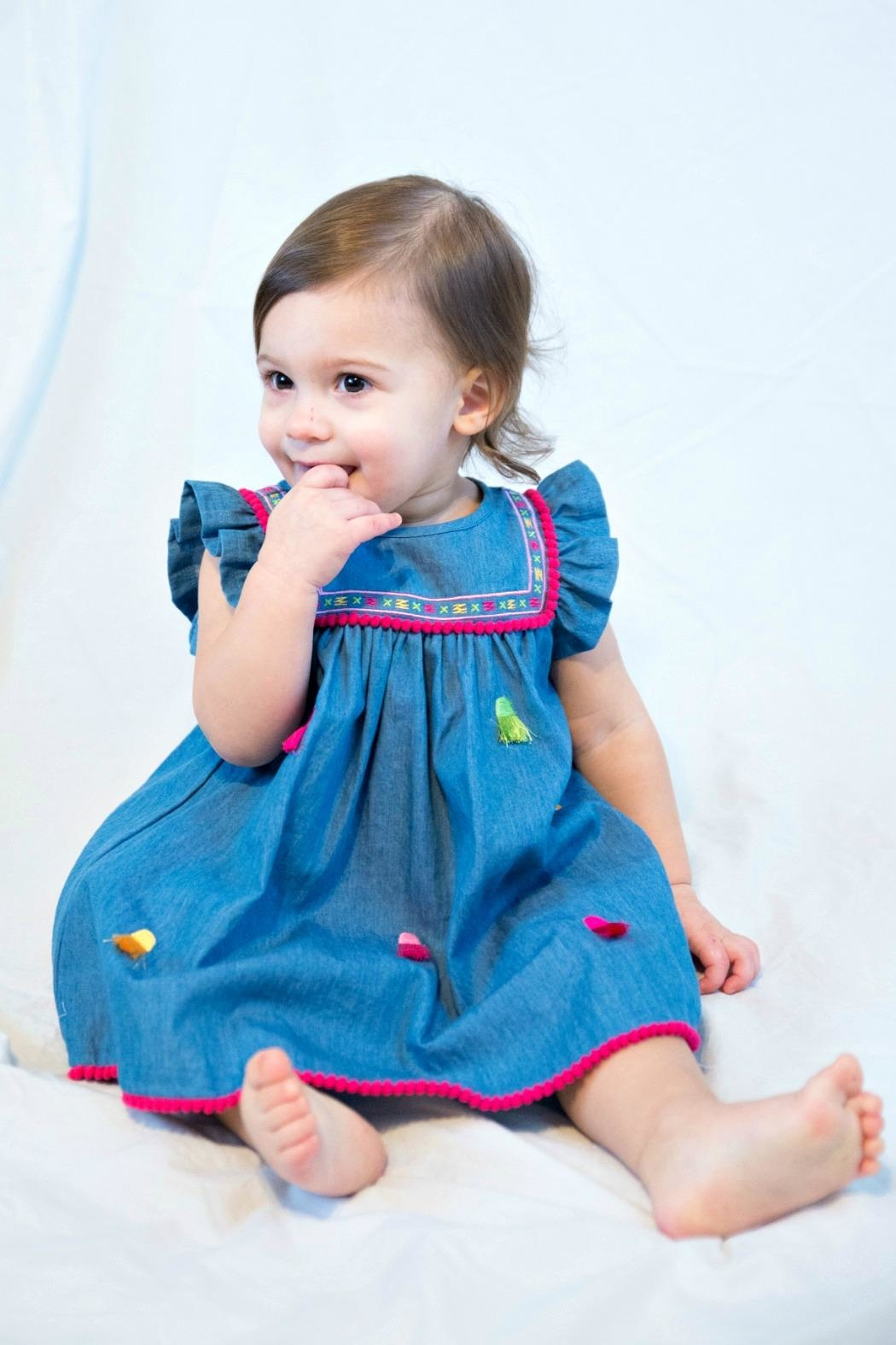 Cutie Pie Baby Embroidered-Yoke-Pom-Pom-Fringe Chambray Dress - Main Image