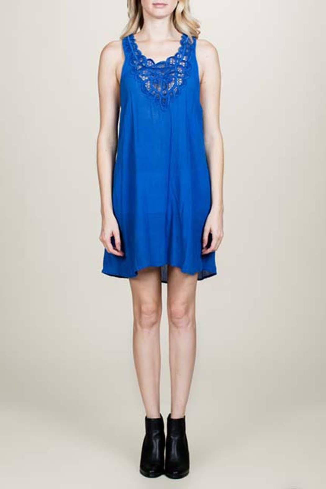 En creme blue embroidered dress from california by jasper