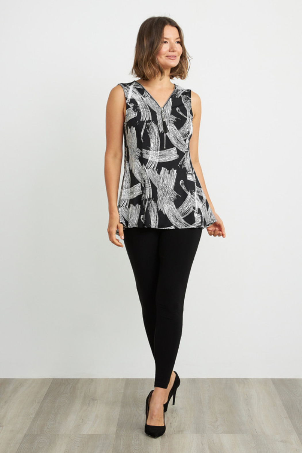 Joseph Ribkoff  Eye-catching, etching-inspired print v-neck, sleeveless top. Accented with a shimmering zip detail. - Back Cropped Image