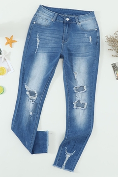 The Emerald Fox Boutique Faded Mid High Rise Jeans with Holes - Product List Image