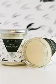 Falling Into Place Sweet Wilderness Candle - Back cropped