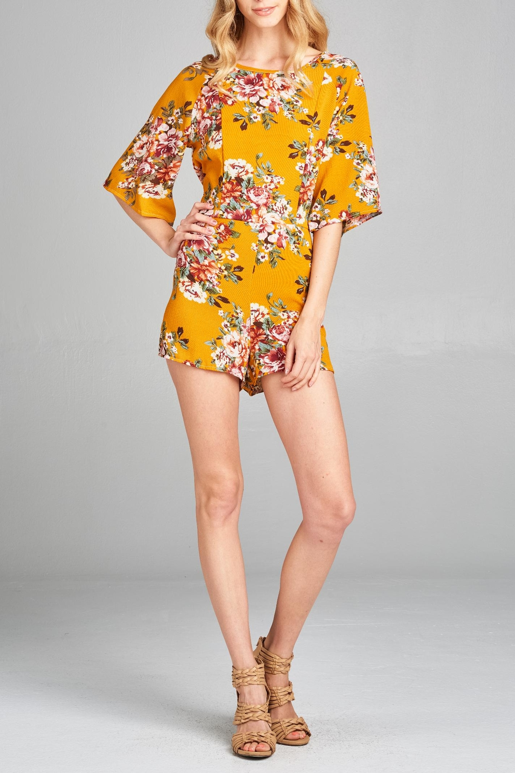 8af811e245dd Racine Floral Cutout Romper from California by Racine Love — Shoptiques