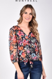 Frank Lyman  Stylish floral design with 3/4 elastic sleeve, V-neck with tie at bottom. - Product Mini Image