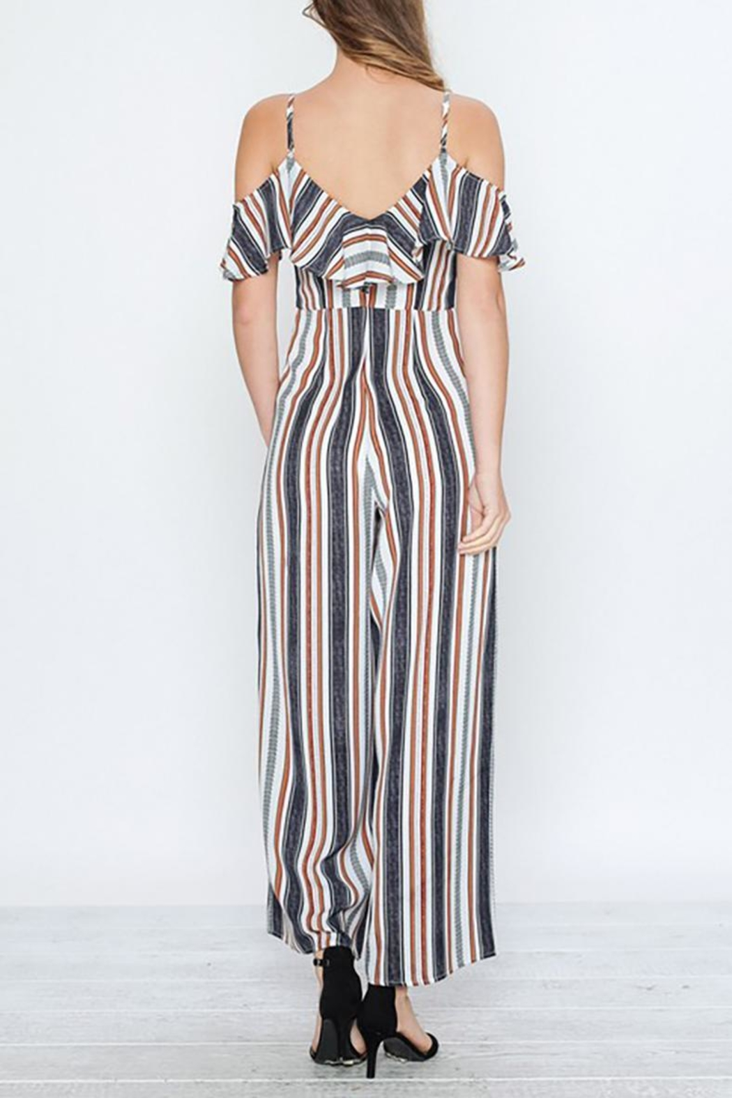 a17d6c81f94f5 Flying Tomato Striped Ruffle Jumpsuit from Virginia by mod soul ...