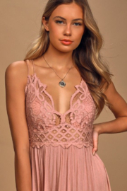 Free People Go for boho glam in this creation from , a flowing slip dress with a crochet at the bodice and an asymmetrical ruffled hem. - Other
