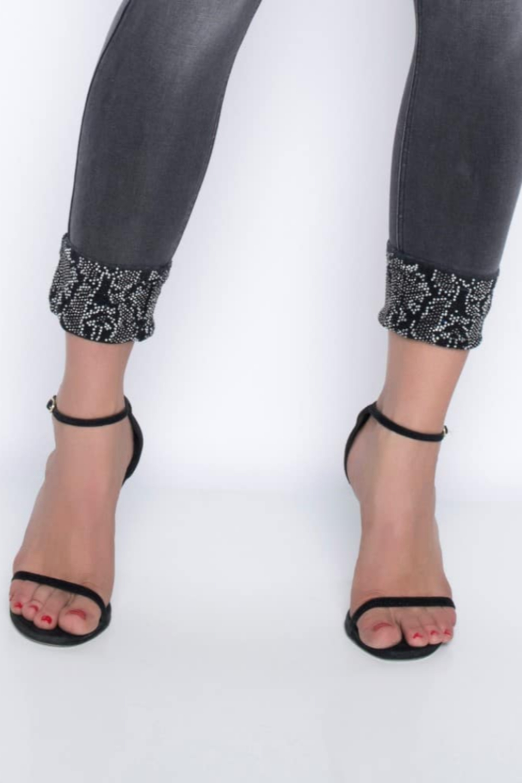 Frank Lyman Grey/silver jeans with rhinestone embellishment on cuffs. - Front Full Image
