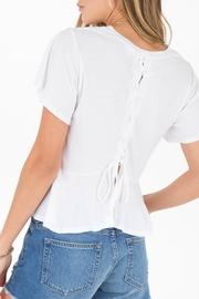Others Follow  Headliner Top - Side cropped