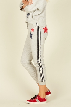 Shoptiques Product: Heather Grey Joggers W/ Red & Blue Stripe