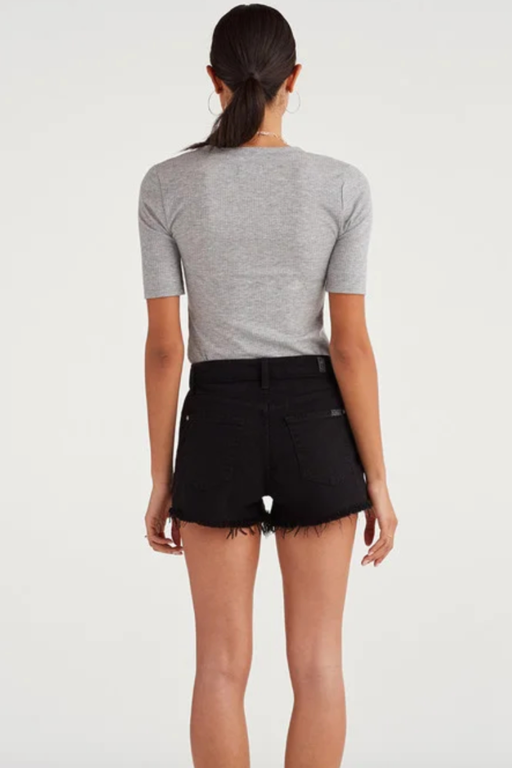 7 For all Mankind High Waist Short with Frayed Hem and Exposed Button Fly in Pitch Black - Front Full Image