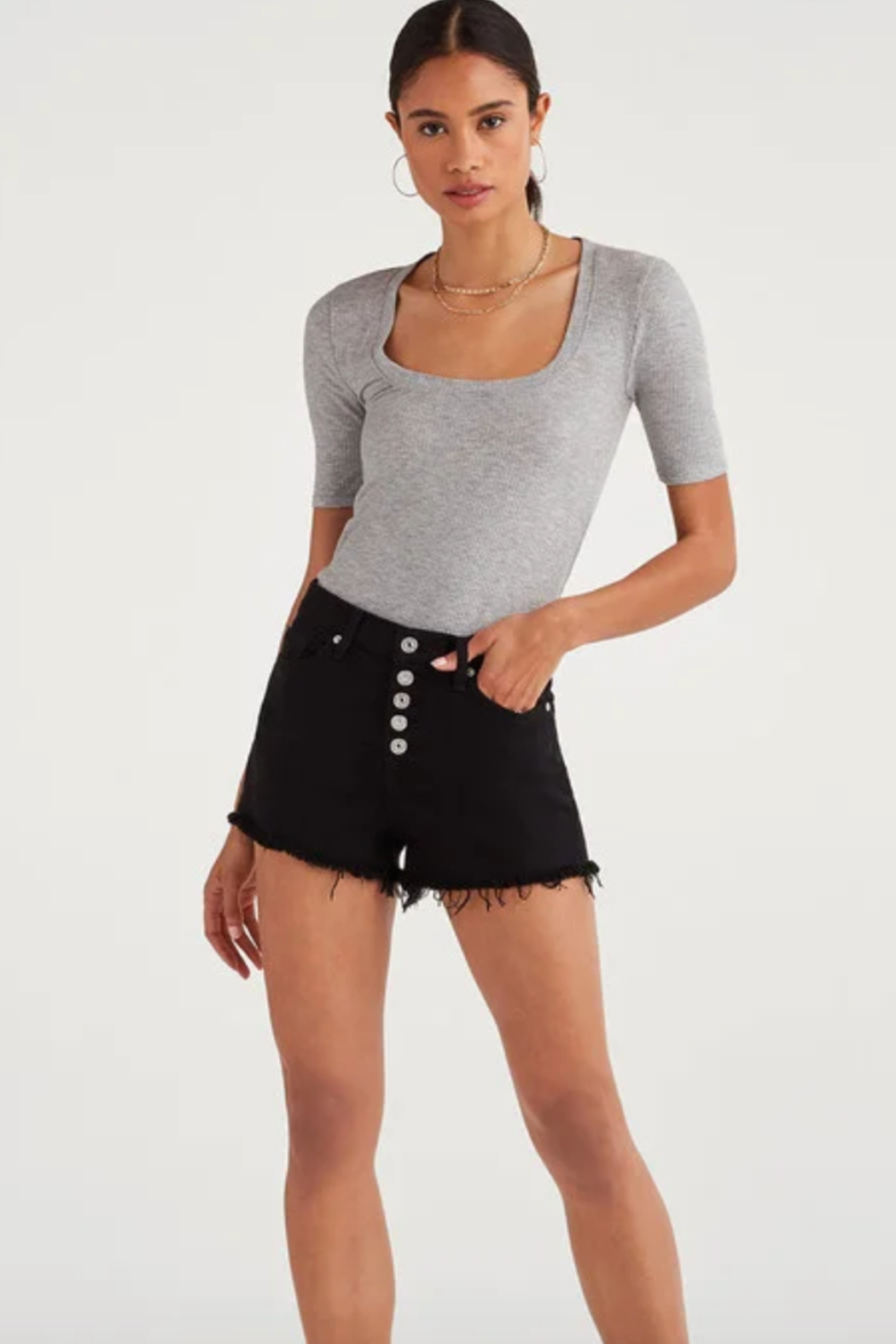 7 For all Mankind High Waist Short with Frayed Hem and Exposed Button Fly in Pitch Black - Main Image