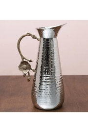 India Handicrafts Flower Hammered Pitcher - Front cropped