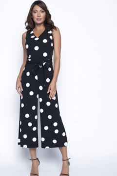 Shoptiques Product: Knit jumpsuit with timeless white polka dots and gaucho style wide leg pant.