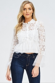 the clothing company Long-Sleeve Ruffle Top - Front cropped