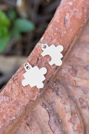 MMA Silver Piece Of Puzzle Charm - Front full body
