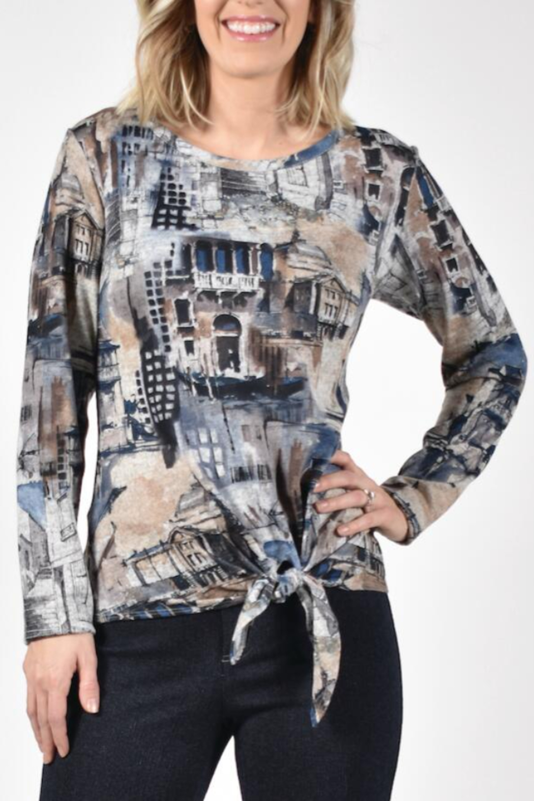 Frank Lyman Multi print top with tie front. Long sleeves, round neckline. - Main Image