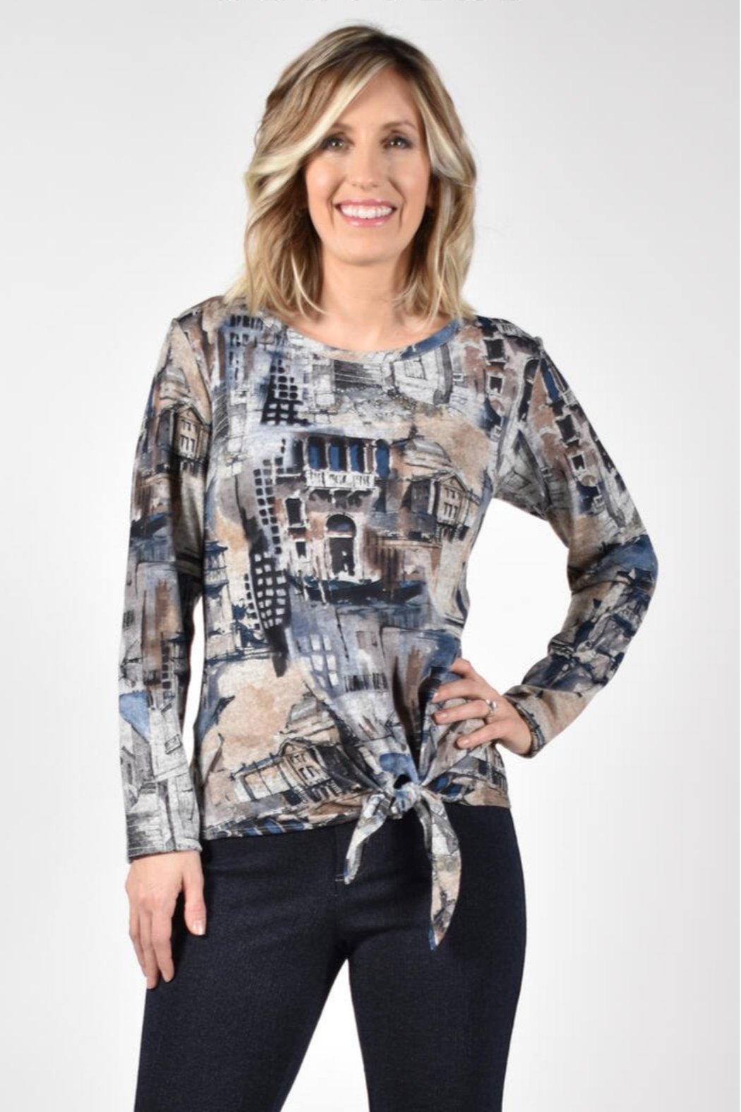Frank Lyman Multi print top with tie front. Long sleeves, round neckline. - Front Full Image