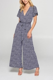 tua Navy Polka-Dot Jumpsuit - Front cropped