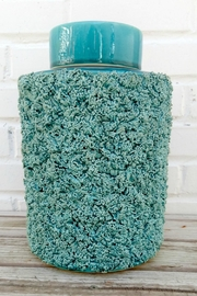 Not Labeled  Teal Textured Container - Front cropped