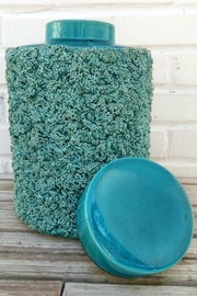 Not Labeled  Teal Textured Container - Front full body