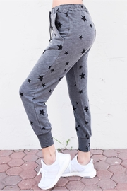 Olivaceous Star Print Joggers - Front cropped