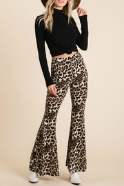 Pretty Little Things Leopard Flare Pants - Product Mini Image