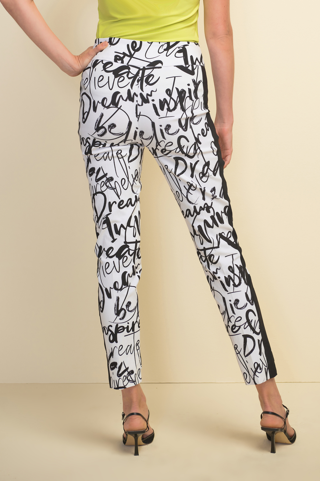Joseph Ribkoff  Slim fit pull-on white crop pants with black design throughout. - Main Image