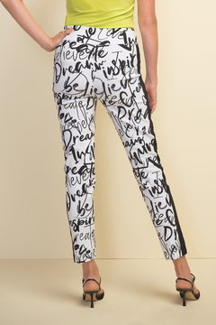 Shoptiques Product: Slim fit pull-on white crop pants with black design throughout.