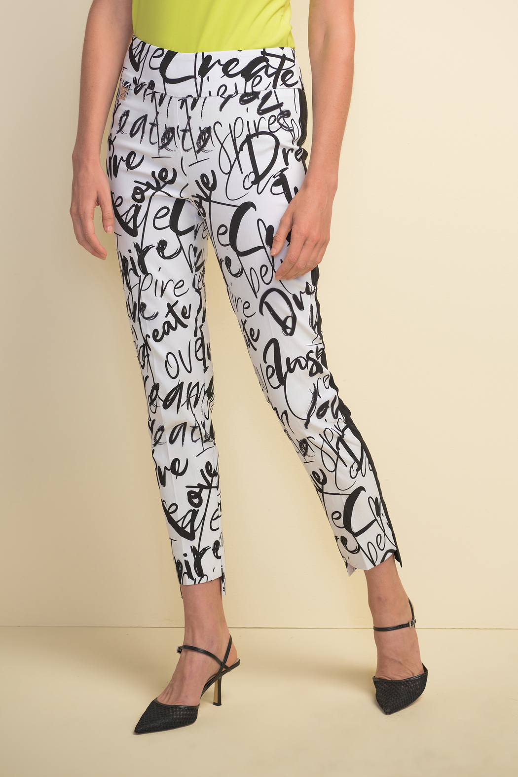 Joseph Ribkoff  Slim fit pull-on white crop pants with black design throughout. - Front Cropped Image