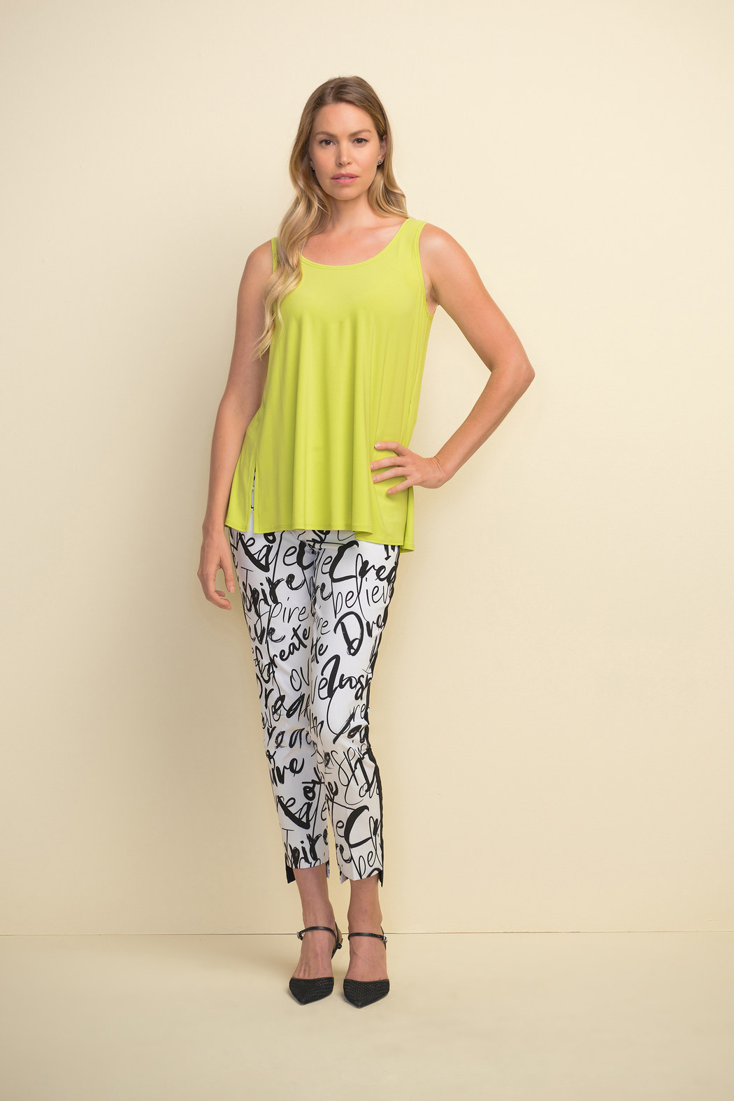 Joseph Ribkoff  Slim fit pull-on white crop pants with black design throughout. - Side Cropped Image