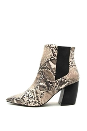 Buy Now: Beige Snakeskin Booties. Featured at RMNOnline Fashion Group (#RMNOnline)